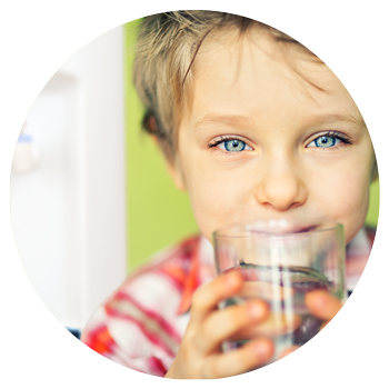 Kid drinking from a MOJO bottleless water cooler